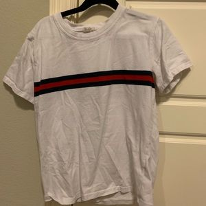 blue and red striped white tee